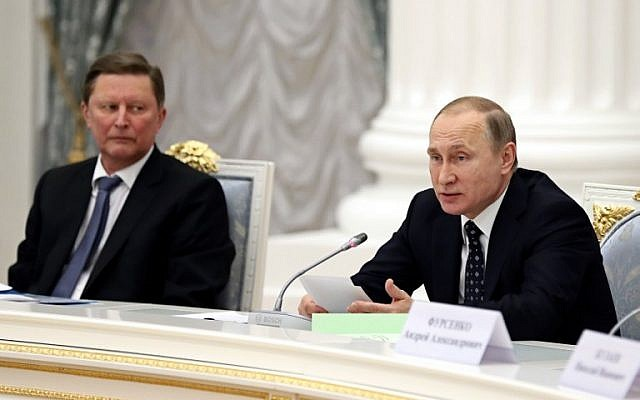 Russian President Vladimir Putin, right, speaks as Sergei Ivanov, Chief of Staff of the Presidential Administration looks at him in  the Kremlin, Moscow, January 21, 2016. (AFP/POOL)