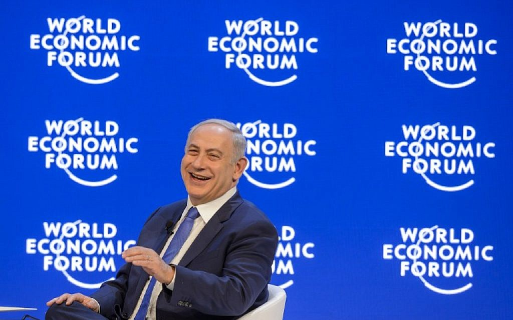 Prime Minister Benjamin Netanyahu laughs during a conference at the World Economic Forum (WEF) annual meeting in Davos,  on January 21, 2016. (AFP/FABRICE COFFRINI)