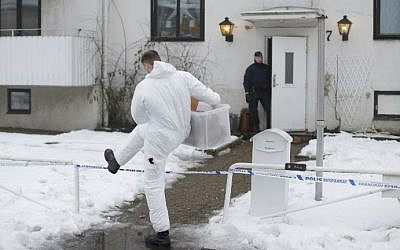 Police investigators are seen outside a home for juvenile asylum seekers in Molndal in southwestern Sweden on January 25, 2016 following the stabbing death of a shelter employee. (Adam Ihse/TT News Agency/AFP)