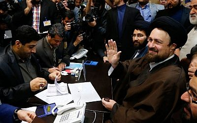 Hassan Khomeini, right, grandson of the Islamic Republic of Iran's founder, Ayatollah Ruhollah Khomeini, registering his candidacy for the Assembly of Experts elections at the interior ministry in Tehran on December 18, 2015. (AFP/STR)