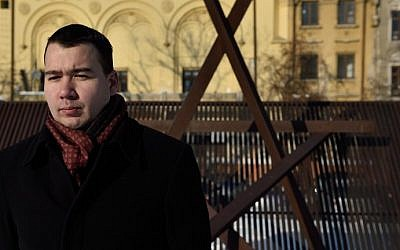 Historian Alexandru Climescu poses for a picture at the monument of the Holocaust memorial in Bucharest on January 25, 2016. (AFP / DANIEL MIHAILESCU)