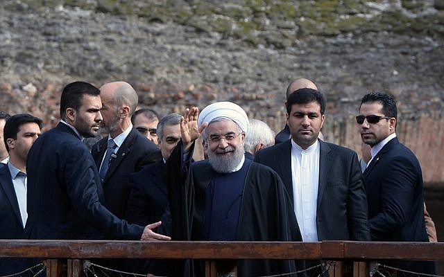 Iranian President Hassan Rouhani, center, waves to photographers during his visit to Rome's Coliseum January 27, 2016. (AFP/FILIPPO MONTEFORTE)