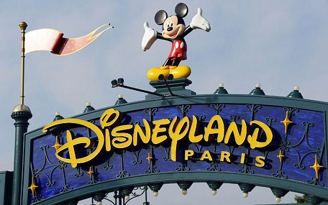 This file photo taken on August 13, 2015 shows a sign above the entrance at Disneyland Paris in Marne-la-Vallee. (AFP / BERTRAND GUAY)