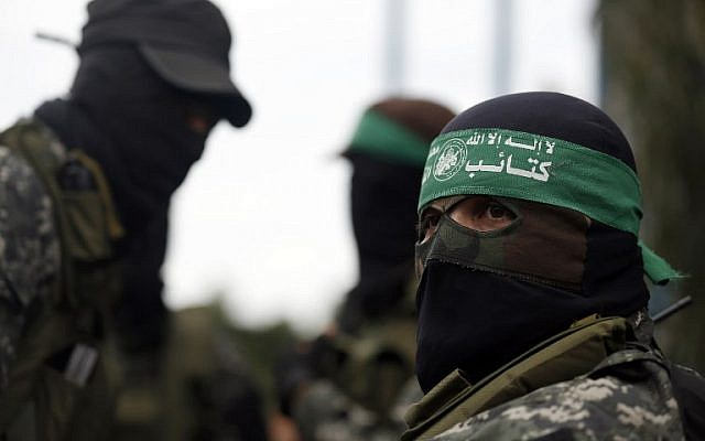 Hamas fighters attend a funeral procession in Gaza City on January 29, 2016, for seven members of the terror group killed when an attack tunnel into Israel collapsed. (AFP/Mohammed Abed)