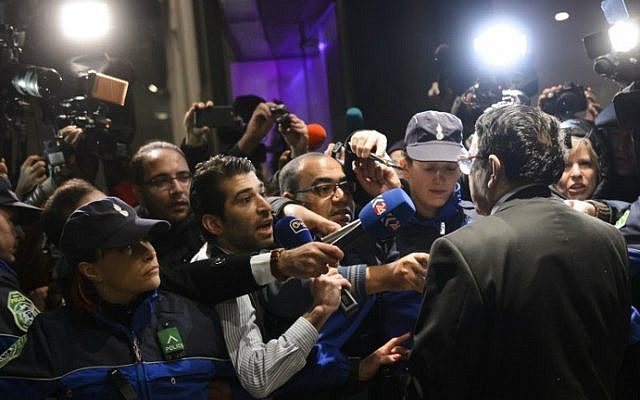 High Negotiations Committee (HNC) spokesman Riyad Naasan Agha of Syria's main opposition body (R back) briefs the press upon his arrival on January 30, 2016 in Geneva for peace talks. (Fabrice Coffrini/AFP)