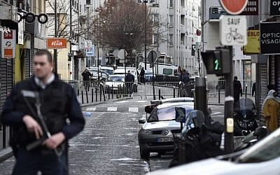 French policemen stand guard at Rue de la Goutte d'Or in the north of Paris on January 7, 2016, near the site where police shot a knife-wielding man dead as he was trying to enter a police station (Alain Jocard/AFP)