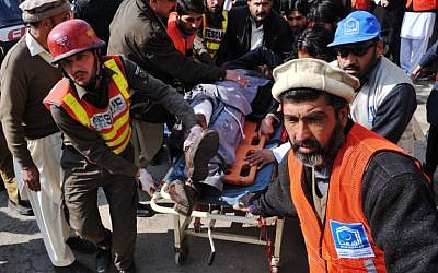 Illustrative: Pakistani rescuers shift an injured man to a hospital following an attack by gunmen in the Bacha Khan university in Charsadda, about 50 kilometers from Peshawar, on January 20, 2016. (AFP Photo/Hasham Ahmed)
