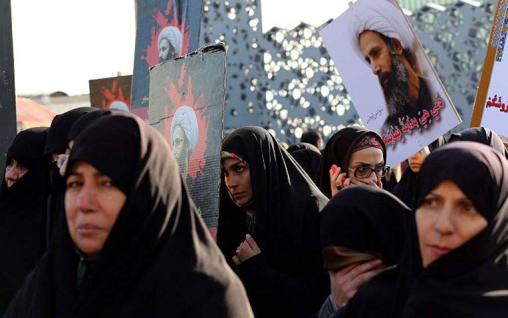 Iranian women gather during a demonstration against the execution of prominent Shiite Muslim cleric Nimr al-Nimr by Saudi authorities, at Imam Hossein Square in the capital Tehran on January 4, 2016. (AFP Photo/Atta Kenare)