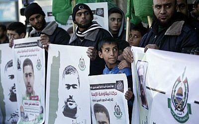 File: Palestinian supporters of the Hamas terror group mourn Nashat Milhem, an Arab Israeli who murdered three people in a Tel Aviv shooting spree January 1, 2016, during a rally in Gaza City on January 9, 2016. (AFP/Mahmud Hams)