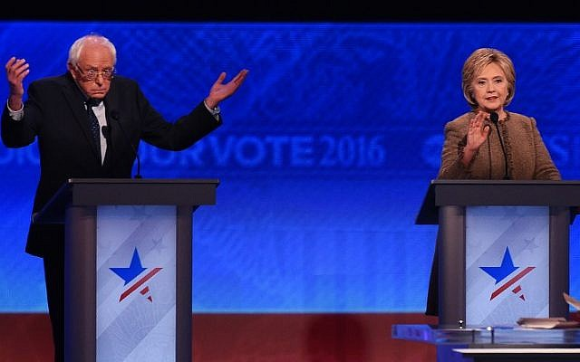US Democratic presidential hopefuls Hillary Clinton (R) and Bernie Sanders participate in the Democratic Presidential Debate hosted by ABC News at Saint Anselm College in Manchester, New Hampshire, on December 19, 2015. (AFP PHOTO/JEWEL SAMAD)