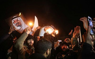 Iranian protesters with photos of ex-defense minister of Saudi Arabia and late Crown Prince Sultan bin Abdul Aziz al-Saud gather outside the Saudi Embassy in Tehran during a demonstration against the execution of prominent Shiite Muslim cleric Nimr al-Nimr by Saudi authorities, on January 2, 2016. (AFP/ISNA/Mohammadreza Nadimi)