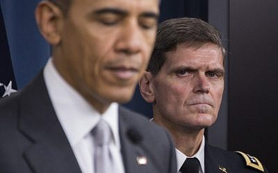 This December 14, 2015 file photo shows US Special Operations Commander General Joseph Votel (R) as he  listens as US President Barack Obama (L) delivers a statement to reporters following a National Security Council meeting on the counter-ISIL in Washington, DC. (AFP PHOTO / JIM WATSON)
