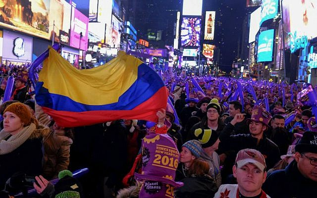 People take part in New Year's Eve celebrations at Times Square on December 31, 2015 in New York City. (Eduardo Munoz Alvarez/Getty Images/AFP)