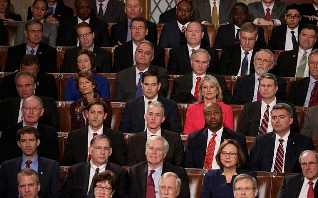 Members of congress listen to US President Barack Obama deliver the State of the Union speech in the House chamber of the US Capitol January 12, 2016 in Washington, DC. (Mark Wilson/Getty Images/AFP)