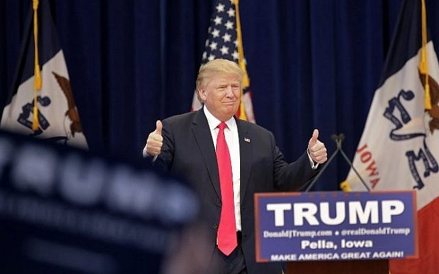 Republican presidential candidate Donald Trump gives a thumbs-up as he is introduced during a campaign event January 23, 2016 in Pella, Iowa.  (Joshua Lott/Getty Images/AFP)