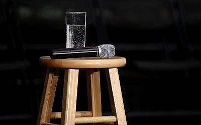 "A microphone and a glass of water for democratic presidential candidate Hillary Clinton sits on a stool during a ""get out the caucus"" event at the University of Northern Iowa on January 26, 2016 in Cedar Falls, Iowa (Justin Sullivan/Getty Images/AFP)"