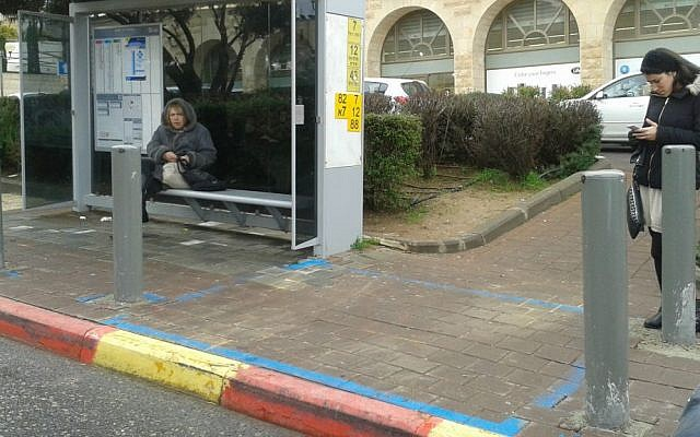 A protected bus stop in Jerusalem made accessible for people in wheelchairs. (Shekel)