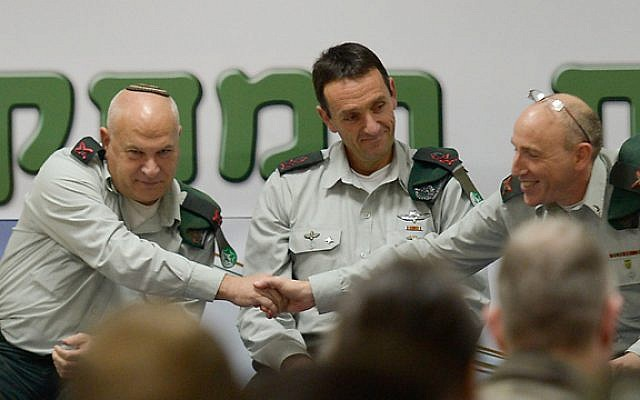 Brig. Gen. Eli Ben-Meir, left, shakes hands with Brig. Gen. (res.) Itai Brun, right, as Ben-Meir takes over as head of the IDF's Research Brigade, during a ceremony, with head of army intelligence Maj. Gen. Herzi Halevi, on January 4, 2015. (IDF Spokesperson's Unit)