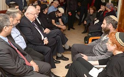 President Reuven Rivlin pays a condolence visit to the family of terror victim Dafna Meir in Otniel on January 21, 2016, four days after she was murdered in a terror attack at her home (Photo: Mark Neyman/GPO)