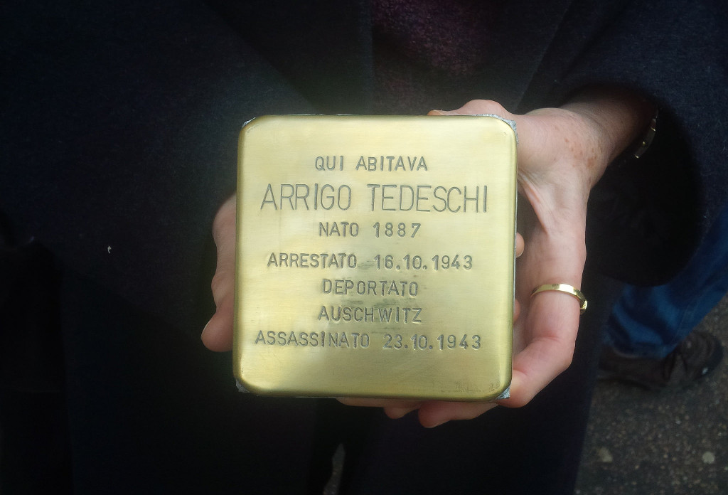 A stolperstein (stumbling block) by artist Gunter Demnig recently laid in a Roman sidewalk. Inscribed with a victim's name and dates, stolpersteins are found all over Europe in an effort to physically jar a visceral memorial of the Holocaust. (courtesy of Pagine Ebraiche)