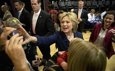 Democratic presidential candidate Hillary Clinton reaches for a smartphone for a selfie with a supporter after a campaign rally in Waterloo, Iowa, on January 11, 2016. (AP/Jae C. Hong)