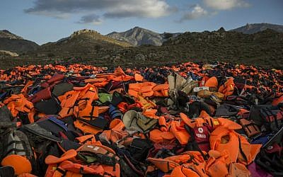 Piles of life jackets used by refugees and migrants to cross the Aegean Sea from the Turkish coast remain stacked on the Greek island of Lesbos, December 2, 2015. (AP/Santi)
