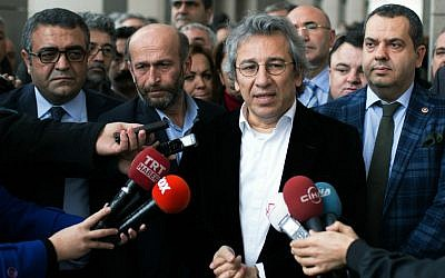 Can Dundar, the editor-in-chief of opposition newspaper Cumhuriyet, second right, and Erdem Gul, the paper's Ankara representative, second left, speak to the media outside a courthouse in Istanbul, Turkey, Thursday, Nov. 26, 2015.  (AP Photo/Vedat Arik, Cumhuriyet)