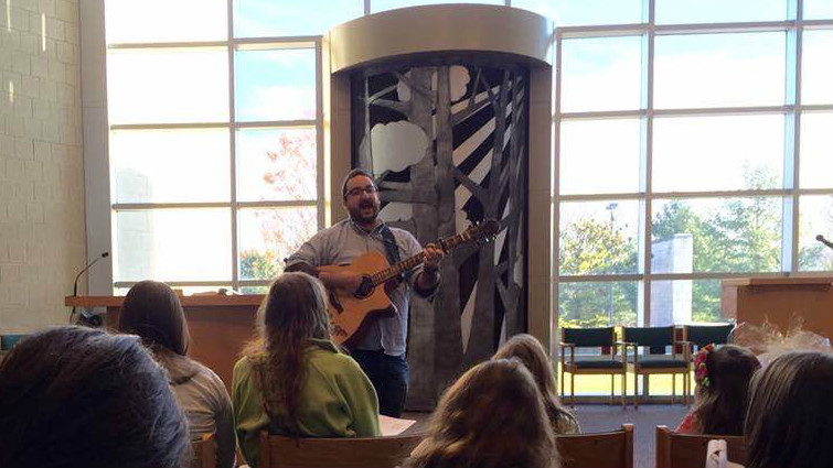 Student rabbi Adam Bellows leads services in Flint's Reform Temple Beth El. (courtesy)
