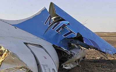 The tail of a Metrojet plane that crashed in Hassana, Egypt carrying 224 people on Saturday, October 31, 2015. (Suliman el-Oteify/Egyptian Prime Minister's Office via AP)