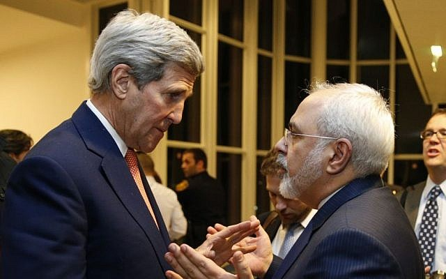 US Secretary of State John Kerry, left, talks with Iranian Foreign Minister Mohammad Javad Zarif, right, in Vienna, Austria, on January 16, 2016. (Kevin Lamarque/Pool via AP)