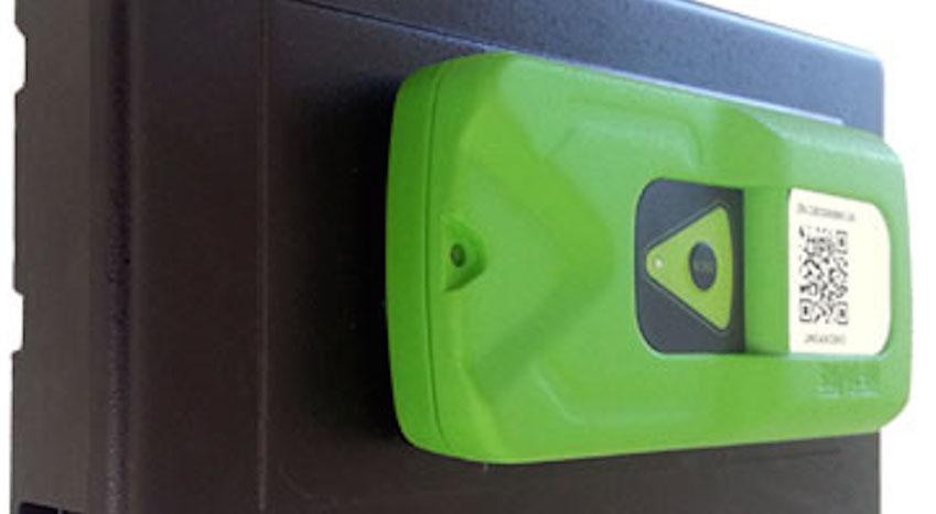 An IoTBox sensor (in green) atop a manual rat trap (Couertesy)