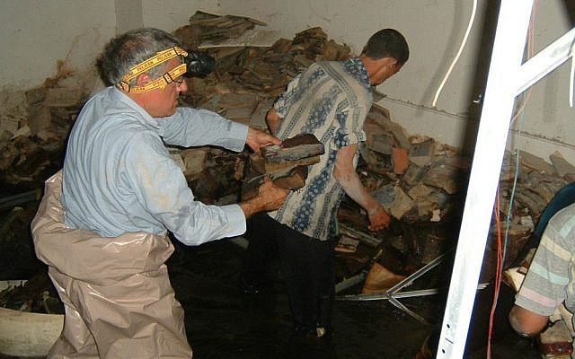 Volunteers attempt to recover Iraqi Jewish archival material from the flooded basement of the Mukhabarat, Saddam Hussein's intelligence headquarters, 2003. (Harold Rhode, Courtesy of the US National Archives)