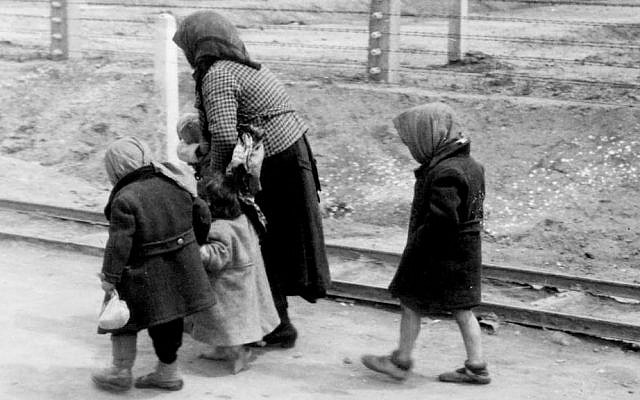 File: An old Jewish woman with children at Auschwitz-Birkenau, May 1, 1944. (Wikipedia/Hannolans/CC BY-SA 3.0 DE)