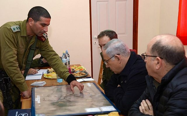 Prime Minister Benjamin Netanyahu, center, and then-defense minister Moshe Ya'alon, right,  during a visit to the settlement of Otniel in the West Bank, January 19, 2016. (Government Press Office)