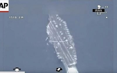 Footage alleged to be taken from an Iranian drone showing a US aircraft carrier in the Persian Gulf. (YouTube/Associated Press)