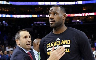 In this Nov. 2, 2015, file photo, Cleveland Cavaliers coach David Blatt pats LeBron James on the chest at the end of an NBA basketball game against the Philadelphia 76ers in Philadelphia. (AP Photo/Michael Perez, File)