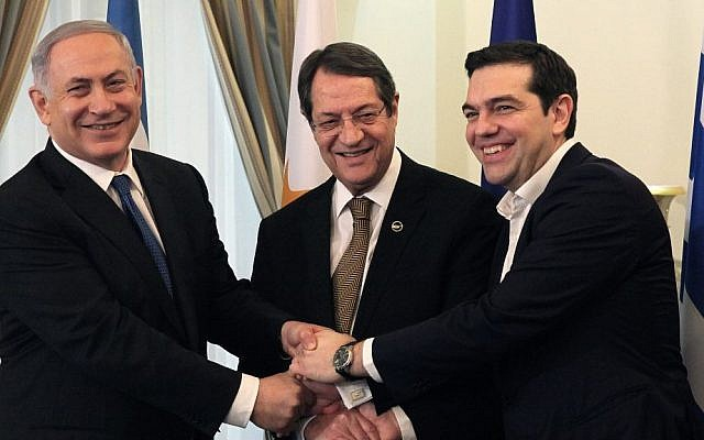 Prime Minister Benjamin Netanyahu, Cypriot President Nicos Anastasides, center and Greek Prime Minister Alexis Tsipras shake hands during a meeting at the presidential palace in the Cypriot capital, January 28, 2016. (Yiannis Kourtoglou, Pool Photo via AP)
