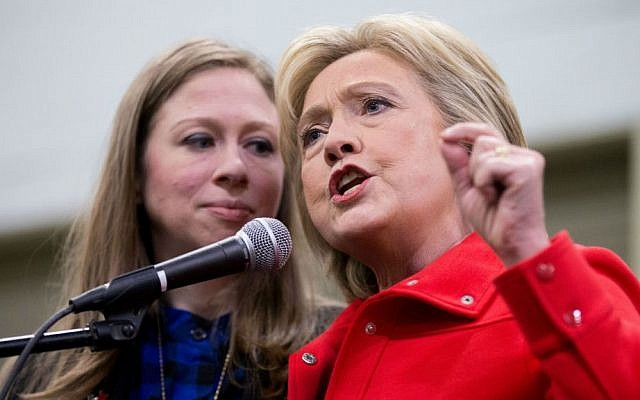 Democratic presidential candidate Hillary Clinton, accompanied by her daughter Chelsea Clinton, speaks at the African American Festival, I'll Make Me a World Celebration Day at the Iowa Events Center in Des Moines, Iowa, Saturday, Jan. 30, 2016. (AP Photo/Andrew Harnik)
