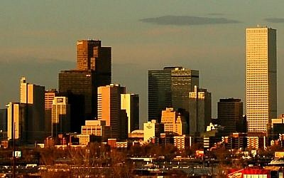 File: The Denver, Colorado skyline at sunset, seen from the southwest. (Wikipedia/cougarrugbyclub.com/CC BY 3.0)