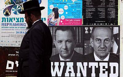 """A mock """"Wanted"""" poster in Jerusalem shows former prime ministers Ehud Olmert and Ehud Barak, April 15, 2010. (Abir Sultan/Flash 90)"""
