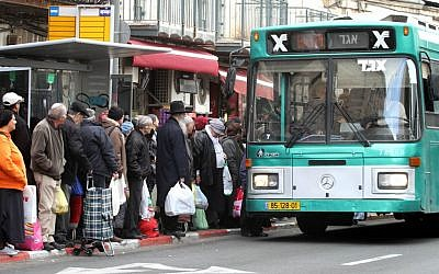 Illustrative: Israelis waiting to board an Egged bus in the center of Jerusalem, January 17, 2012. (Miriam Alster/ Flash90)