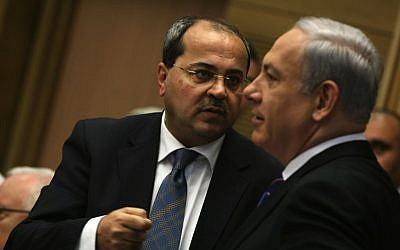 Joint (Arab) List MK Ahmad Tibi, left, speaks with Prime Minister Benjamin Netanyahu during a Knesset session, February 13, 2012. (Kobi Gideon/Flash90)