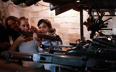 Tourists at the 'slik,' or hidden weapons cache, in Kfar Giladi (Yossi Zamir/Flash90)