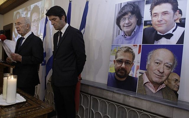 """Former Israeli president Shimon Peres (L) and French Ambassador to Israel Patrick Maisonnave seen during a gathering in solidarity with French newspaper Charlie Hebdo at the """"Maison de France"""" in Tel Aviv on January 8, 2015, a day after two gunmen killed 11 people in an Islamist attack at Charlie Hebdo's editorial office in Paris. (Amir Levy/Flash90)"""