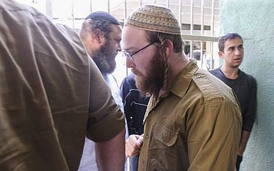 Corporal Elad Yaakov Sela from the Bat Ayin settlement is brought to court in Tel Aviv on April 13, 2015. (Flash90)