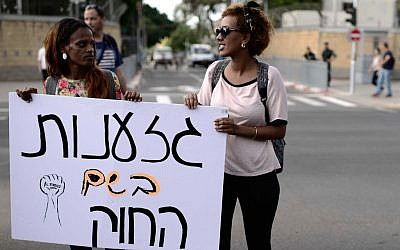 Israeli-Ethiopians and activists shout slogans during a protest march in Tel Aviv.