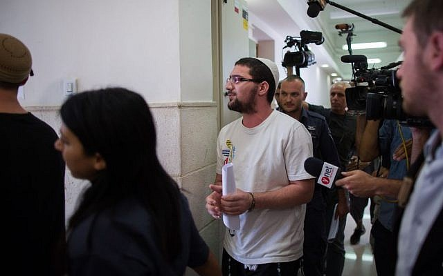 Nachman Tuito, member of the right-wing Lehava organization seen outside the courtroom of the District Court in Jerusalem, July 22, 2015. (Yonatan Sindel/Flash90)