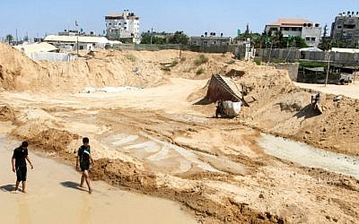 Palestinians inspect the damage after Egyptian forces flooded smuggling tunnels dug beneath the Gaza-Egypt border, in Rafah in the southern Gaza Strip, on September 18, 2015. (Abed Rahim Khatib/ Flash90)