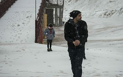Israelis in the snow on Mount Hermon during a winter storm sweeping through the country, December 31, 2015. (Basel Awidat/Flash90)