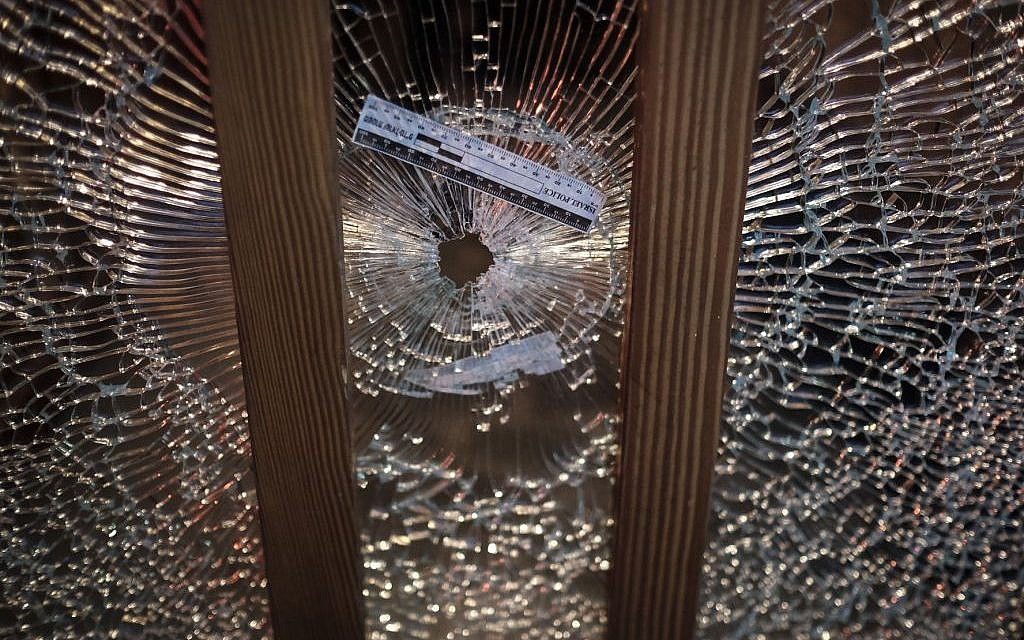 A gun shot hole in a glass window at the scene of a shooting attack at the Simta bar in central Tel Aviv, on Friday, January 1, 2016. (Tomer Neuberg/Flash90)